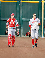 Yasmani Grandal (L), Ismael Guillon (R) - 2010 AZL Reds - Grandal, the Reds 1st round pick, and Guiilon, walk in from the bullpen just before the Arizona League semi-final playoff game against the Giants at Scottsdale Stadium, Scottsdale, AZ - 08/30/2010.Photo by:  Bill Mitchell/Four Seam Images..