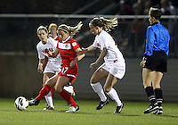 BOYDS, MARYLAND - April 06, 2013:  Hayley Siegel (17) of The Washington Spirit passes the ball away from Campbell Millar (20) of the University of Virginia women's soccer team in a NWSL (National Women's Soccer League) pre season exhibition game at Maryland Soccerplex in Boyds, Maryland on April 06. Virginia won 6-3.