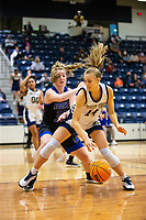 Ashley Rangel (14) of Bentonville West dribbles the ball with Taylor Treadwell (33) of Rogers behind defending at Wolverine Arena, Centerton,  AR, Tuesday, January 12, 2021 / Special to NWA Democrat-Gazette/ David Beach