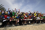 Local school children out in force to cheer on Sky Team before the start of the 3rd Stage of the 2012 Tour of Qatar running 146.5km from Dukhan Souq, Dukhan to Al Gharafa, Qatar. 7th February 2012.<br /> (Photo Eoin Clarke/Newsfile)