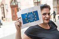 Bundesregierung gedenkt der Opfer von Flucht und Vertreibung.<br /> Am 20. Juni 2016 begeht die Bundesregierung mit einer Gedenkstunde im Schlueterhof des Deutschen Historischen Museums in Berlin den Gedenktag für die Opfer von Flucht und Vertreibung.<br /> Mit diesem Gedenktag wird seit 2015 jaehrlich am 20. Juni an die Opfer von Flucht und Vertreibung weltweit sowie insbesondere an die deutschen Vertriebenen erinnert.<br /> Im Bild: Einige junge Menschen protestierten waehrend der Veranstaltung mit Rufen und Schildern gegen die Fluechtlingspolitik der Bundesregierung. Sie wurden nach wenigen Minuten aus dem Saal geworfen.<br /> 20.6.2016, Berlin<br /> Copyright: Christian-Ditsch.de<br /> [Inhaltsveraendernde Manipulation des Fotos nur nach ausdruecklicher Genehmigung des Fotografen. Vereinbarungen ueber Abtretung von Persoenlichkeitsrechten/Model Release der abgebildeten Person/Personen liegen nicht vor. NO MODEL RELEASE! Nur fuer Redaktionelle Zwecke. Don't publish without copyright Christian-Ditsch.de, Veroeffentlichung nur mit Fotografennennung, sowie gegen Honorar, MwSt. und Beleg. Konto: I N G - D i B a, IBAN DE58500105175400192269, BIC INGDDEFFXXX, Kontakt: post@christian-ditsch.de<br /> Bei der Bearbeitung der Dateiinformationen darf die Urheberkennzeichnung in den EXIF- und  IPTC-Daten nicht entfernt werden, diese sind in digitalen Medien nach §95c UrhG rechtlich geschuetzt. Der Urhebervermerk wird gemaess §13 UrhG verlangt.]