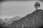The smoke plume from an explosion is seen after a fighter jet dropped a bomb on a Taliban position overlooking Observation Post Mace near Gowerdesh, in northern Kunar, 24 November 2011. (John D McHugh)