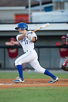 Trey Stover (11) of the Burlington Royals follows through on his swing against the Johnson City Cardinals at Burlington Athletic Park on August 22, 2015 in Burlington, North Carolina.  The Cardinals defeated the Royals 9-3. (Brian Westerholt/Four Seam Images)