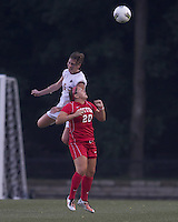 Boston College defender Alyssa Pember (6) and Boston University midfielder Krista Minto (20) battle for head ball. After 2 complete overtime periods, Boston College tied Boston University, 1-1, after 2 overtime periods at Newton Soccer Field, August 19, 2011.