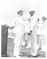 Adm. Chester W. Nimitz awards SC2 Doris (Dorie) Miller, USN, The Navy Cross at Pearl Harbor for heroism on the USS West Virginia, 03/1942