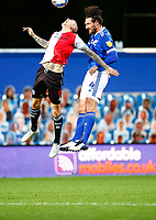 31st October 2020; The Kiyan Prince Foundation Stadium, London, England; English Football League Championship Football, Queen Park Rangers versus Cardiff City; Sean Morrison of Cardiff City and Lyndon Dykes of QPR leap high to challenge for a header