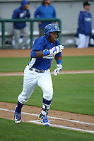 Johan Mieses (18) of the Rancho Cucamonga Quakes runs to first base during a game against the Lake Elsinore Storm at LoanMart Field on April 10, 2016 in Rancho Cucamonga, California. Lake Elsinore defeated Rancho Cucamonga, 7-6. (Larry Goren/Four Seam Images)