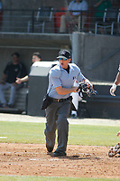 Umpire Ben Phillips calls a runner out at home during a game between the Carolina Mudcats and Down East Wood Ducks  on April 27, 2017 at Five County Stadium in Zebulon, North Carolina. Carolina defeated Down East 9-7. (Robert Gurganus/Four Seam Images)