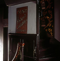 A detail of a wooden staircase with a built in cupboard to one side