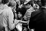 Former President Barack Obama interacts with children in the crowd as he works the rope line after rallying for Democratic candidates top for election in the November Mid-term Elections.