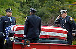 Hartford firefighters prepare to remove the casket containing the remains of their colleague, firefighter Kevin Bell, to the church, during a funeral service, Monday, Oct. 13, 2014, at First Cathedral Church in Bloomfield. Bell was killed at a house fire in last week Hartford. (Jim Michaud / Journal Inquirer)