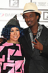 TOKYO - MAY 29: Ai (L) and K'Naan arrive at the red carpet of the World Stage MTVJ 2010 show, May 29, 2010 at Yoyogi National Stadium in Tokyo, Japan.