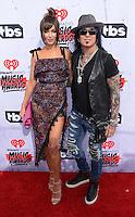 Nikki Sixx + wife Courtney Sixx @ the 2016 iHeart Radio Music awards held @ the Forum.<br /> April 3, 2016