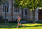 Oct. 8, 2013; A students jogs on South Quad. Photo by Barbara Johnston/University of Notre Dame