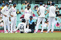 8th January 2021; Sydney Cricket Ground, Sydney, New South Wales, Australia; International Test Cricket, Third Test Day Two, Australia versus India; Hanuma Vihari of India is attended to after getting hit on the leg