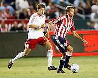 Chivas USA midfielder, Jesse Marsch(15) looks for options upfield while NY Red Bulls midfielder, Luke Sassano(32) chases from behind. Chivas USA  took on the NY Red Bulls on June 28, 2008 at the Home Depot Center in Carson, CA. The game ended in a 1-1 tie.