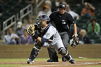 Peoria Javelinas catcher Jason Hagerty #33 blocks home plate as home plate umpire Tripp Gibson looks on during an Arizona Fall League game against the Salt River Rafters at HoHoKam Park on November 3, 2011 in Mesa, Arizona.  Salt River defeated Peoria 13-4.  (Mike Janes/Four Seam Images)