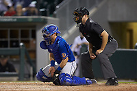 Durham Bulls catcher Mac James (28) bocks a pitch in the dirt as home plate umpire Brian Peterson looks on during the game against the Charlotte Knights at BB&T BallPark on July 31, 2019 in Charlotte, North Carolina. The Knights defeated the Bulls 9-6. (Brian Westerholt/Four Seam Images)