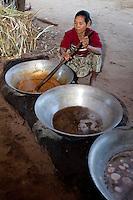 Myanmar, Burma, near Bagan.  Heating Toddy Palm Juice to Make Sugar.
