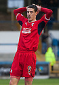 Raith's Brian Graham holds his head after seeing his close range shot saved.