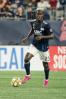 FOXBOROUGH, MA - SEPTEMBER 21: Wilfried Zahibo #23 of New England Revolution prepares to pass the ball down field during a game between Real Salt Lake and New England Revolution at Gillette Stadium on September 21, 2019 in Foxborough, Massachusetts.