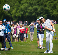 Tommy Fleetwood hits a champions league football with a golf club during the BMW PGA PRO-AM GOLF at Wentworth Drive, Virginia Water, England on 23 May 2018. Photo by Andy Rowland.