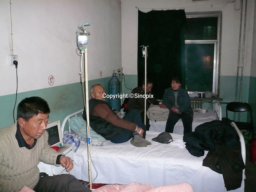 Patients in the Respiratory Disease Ward of Hong Dong County Peoples Hospital, Linfen, Shanxi Province, China. China produces around 2.4 billion tones of coal annually that contributes to more than 400,000 premature deaths annually due to air pollution, acid rain and poisonous ground water. Linfen is reportedly the most polluted city in China...PHOTO BY SINOPIX