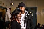 High school couple posing in corridor