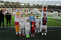 Pictured: Children mascots with Cyril and Cybil the swans Saturday 10 January 2015<br /> Re: Barclays Premier League, Swansea City FC v West Ham United at the Liberty Stadium, south Wales, UK