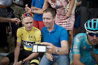 """please look into my phone"": Chris Froome (GBR/SKY) going through the endless selfie-duties bonanza as a trooper being ever so polite to all fans <br /> <br /> Post-Tour Criterium Mechelen 2015"