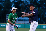 Tashiro Yasunori trainer of Japanese team (L) changing interactions and knowledge with Pakistanis player during the BFA Women's Baseball Asian Cup match between Pakistan and Japan at Sai Tso Wan Recreation Ground on September 4, 2017 in Hong Kong. Photo by Marcio Rodrigo Machado / Power Sport Images