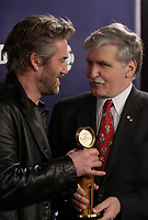 Montreal (Qc) Canada - March 9, 2008 -<br /> Roy Dupuis (L), Romeo Dallaire (R)<br /> at the 10th Jutras Gala held in Montreal.<br /> <br /> Dupuis won the  Best Actor Jutras for his playing the role of General Dallaire in SHAKE HANDS WITH THE DEVIL / J'AI SERRE LA MAIN DU DIABLE.<br /> <br /> photo :(c)  Images Distribution