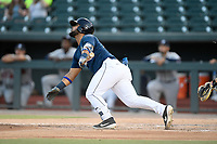 Left fielder Walter Rasquin (22) of the Columbia Fireflies bats in a game against the Rome Braves on Tuesday, June 4, 2019, at Segra Park in Columbia, South Carolina. Columbia won, 3-2. (Tom Priddy/Four Seam Images)