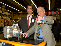 March 20 2003, Montreal, Quebec, Canada<br /> <br />  Andre Caille, President and CEO, Hydro Quebec (Quebec Provincial provider of Electricity) (R) explain to Andre Boisclair , Quebec Environment Minister (L); <br />  the technology used in it's Electric Car presented at Americana, a 3 days <br /> conference & trade show on environement and waste management organized by Reseau Environnement, March 19, 2003 in Montreal, Canada.<br /> <br /> Electric cars fits into Quebec and Canada's pledge to conform to Kyoto Protocol by reducing pollution.<br /> <br /> Mandatory Credit: Photo by Pierre Roussel- Images Distribution. (©) Copyright 2003 by Pierre Roussel <br /> <br /> NOTE : <br />  Nikon D-1 jpeg opened with Qimage icc profile, saved in Adobe 1998 RGB<br /> .Uncompressed  Original  size  file availble on request.