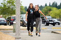 TACOMA, WA - JULY 31: Dani Weatherholt #17 and Phallon Tullis-Joyce #91 of the OL Reign arrive at the stadium before a game between Racing Louisville FC and OL Reign at Cheney Stadium on July 31, 2021 in Tacoma, Washington.