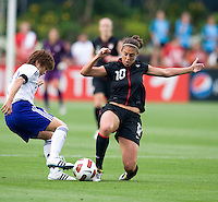 Carli Lloyd (10) of the USWNT fights for the ball with Nahomi Kawasumi (11) of Japan during the game at WakeMed Soccer Park in Cary, NC.   The USWNT defeated Japan, 2-0..