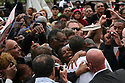 President Barack Obama speaks to an enthusiastic crowd during a Labor Day event in the shadow of the GM Renaissance Center in Detroit Mich., Monday, Sept. 5, 2011