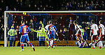 Billy McKay scores the winning goal for Inverness as Wes Foderingham can't get across his goal to prevent it going in
