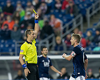 Foxborough, Massachusetts - May 12, 2018: In a Major League Soccer (MLS) match, New England Revolution (blue/white) defeated Toronto FC (red), 3-2, at Gillette Stadium.<br /> Yellow Card: Scott Caldwell