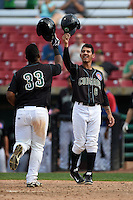 Kane County Cougars shortstop Carlos Penalver (6) greets Jeffrey Baez (33) after a home run during a game against the Quad Cities River Bandits on August 20, 2014 at Third Bank Ballpark in Geneva, Illinois.  Kane County defeated Burlington 7-3.  (Mike Janes/Four Seam Images)