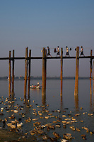 The U-Bein Bridge, the teakwood bridge spans 1.2 km across the shallow Taungthaman Lake some 10 km south of Mandalay. Amanpura, Mandalay, Myanmar/Burma