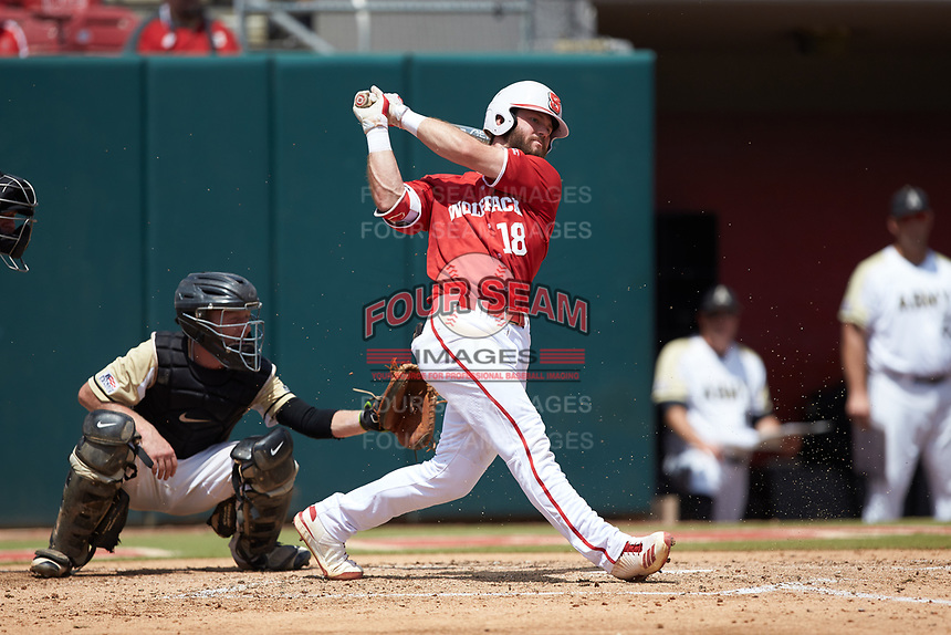 Evan Edwards (18) of the North Carolina State Wolfpack follows through on his swing against the Army Black Knights at Doak Field at Dail Park on June 3, 2018 in Raleigh, North Carolina. The Wolfpack defeated the Black Knights 11-1. (Brian Westerholt/Four Seam Images)