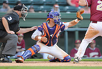Catcher Spencer Kieboom (22) of the Clemson Tigers in a game against the Elon College Phoenix on March 21, 2012, at Fluor Field at the West End in Greenville, South Carolina. Clemson won 4-2, giving head coach Jack Leggett his 1,200th win. (Tom Priddy/Four Seam Images)