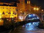 Tiber River flowing near the Isola Tiberina.  On the right is the Ponte Fabricio bridge.