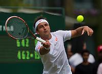 England, London, 23.06.2014. Tennis, Wimbledon, Marinko Matsosevic (AUS)<br /> Photo:Tennisimages/Henk Koster