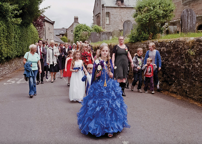 """Queen of Winster Wakes, Natasha Slater leading the people of her village to Holy Trinity church for blessings.<br /> <br /> """"We are also called to be generous to those in need."""""""