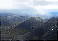 A rainstorm passes over Alaska's Brooks Range.