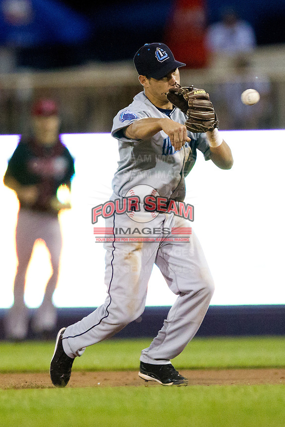 Argenis Martinez (13) of the Lake County Captains throws to first during the Midwest League All-Star Game at Modern Woodmen Park on June 21, 2011 in Davenport, Iowa. (David Welker / Four Seam Images)