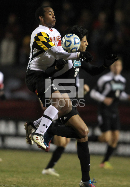 COLLEGE PARK, MD - NOVEMBER 25, 2012: Jordan Cyrus (14) of the University of Maryland clashes with Pedro Ribeiro (10) of Coastal Carolina University during an NCAA championship third round match at Ludwig Field, in College Park, MD, on November 25. Maryland won 5-1.