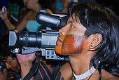 Altamira, Brazil. Encontro Xingu protest meeting about the proposed Belo Monte hydroeletric dam and other dams on the Xingu river and its tributaries. Kayapo video cameraman with Panasonic camera.